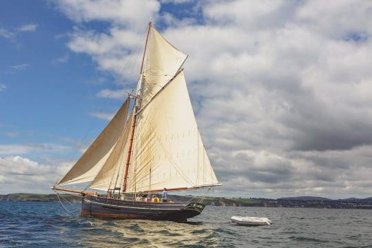 Agnes charter boat full sail in Cornwall