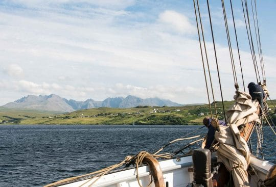 View of the scottish highlands from a tall ship