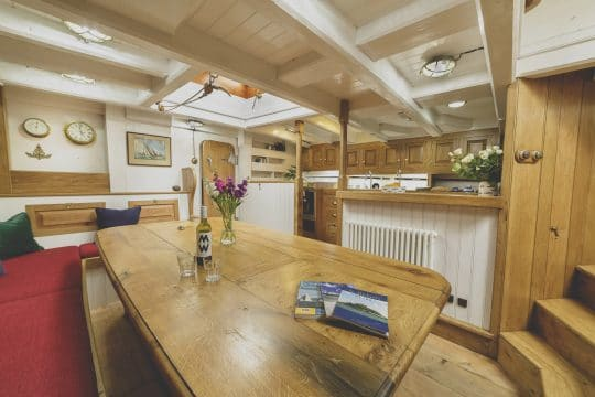 Pellew wooden boat interior dining table