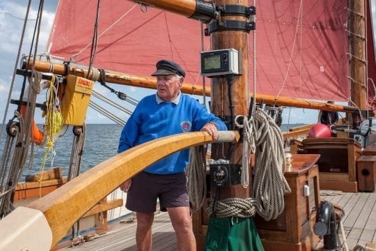 Using the tiller on Pilgrim of Brixham - Ian Kippax