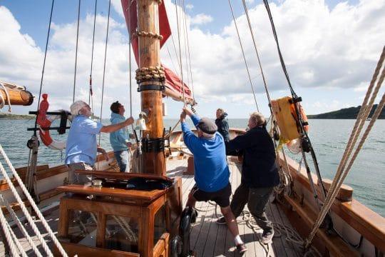 Hoisting sails on Pilgrim of Brixham - Ian Kippax