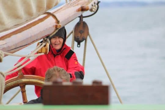 On the helm of a tall ship